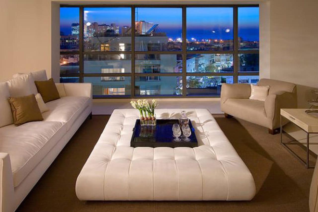 ديكورات غرف الجلوس الدافئة .. لحظات من الراحة العائلية